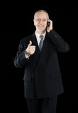 Smiling Thumb Up Businessman on Phone Stock Photos