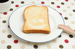Smiling toast. On a plate for breakfast Royalty Free Stock Images