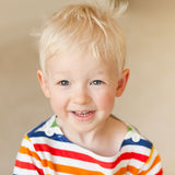 Smiling toddler. Adorable toddler with blond hair smiling Stock Photography