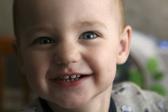 Smiling Toddler. Close-up shot of a two year old male toddler.  The toddler is smiling and looking at the camera Stock Photos