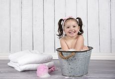 Smiling toddler bathing in tiny bubble bath royalty free stock photo