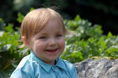 Smiling toddler boy. An outdoor portrait of a smiling boy stock photos