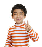 Smiling Toddler Flashes a Victory Sign Stock Image