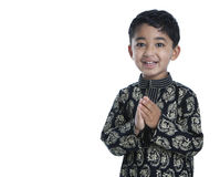 Smiling Toddler with Folded Hands. Signifying Traditional Indian Greeting, Namaste, Isolated, White royalty free stock photo