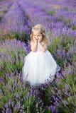 Smiling toddler girl in lavender Stock Images
