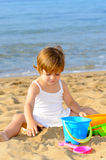 Happy toddler girl playing with her toys at beach Royalty Free Stock Photo
