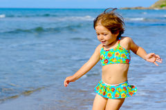 Happy toddler girl running at beach Royalty Free Stock Images