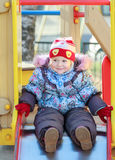 Smiling toddler girl wearing warm autumn clothes Stock Photo