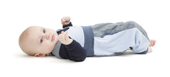 Smiling toddler laying on his back Royalty Free Stock Photo