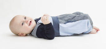 Smiling toddler laying on his back Royalty Free Stock Image