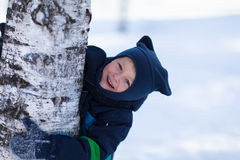 Smiling toddler playing outside on a winter day Stock Photos