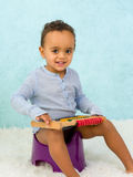 Smiling toddler on potty royalty free stock photography