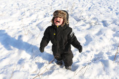 Smiling toddler walking in winter Royalty Free Stock Image