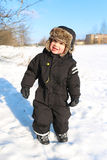 Smiling toddler walking in winter outdoors Royalty Free Stock Photos