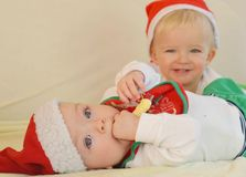 Smiling toddlers wish Merry Christmas Royalty Free Stock Photo