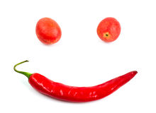 Smiling tomatos and chilli isolated Stock Images