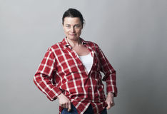 Smiling tomboy mature woman standing showing her wellbeing Stock Images