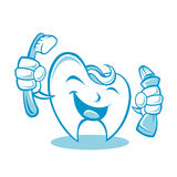 Smiling tooth with toothbrush and toothpaste Stock Photo