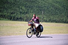 Tourist travel on a bicycle across Altai