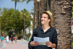 Smiling tourist with map and bag Royalty Free Stock Image