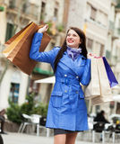 Smiling tourist with shopping bags Stock Image