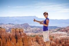 Smiling tourist showing ok sign Stock Photos