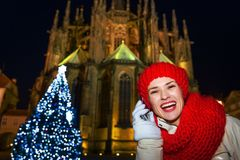 Smiling tourist woman in Christmas Prague speaking on smartphone Royalty Free Stock Photography