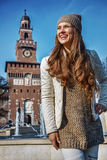Smiling tourist woman near Sforza Castle in Milan, Italy Royalty Free Stock Image