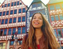 Smiling tourist woman in Romerberg square, Frankfurt, Germany royalty free stock photography
