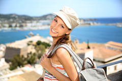 Smiling tourist woman visiting ibiza Royalty Free Stock Images