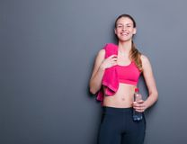 Smiling with towel and water bottle Royalty Free Stock Photos