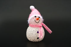 Smiling toy christmas snowman on a black background Stock Photo