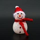 Smiling toy christmas snowman on black Stock Photo