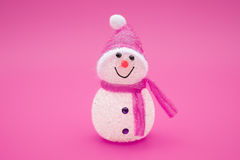 Smiling toy christmas snowman on red background Stock Photography