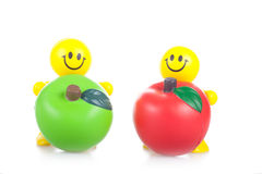 Smiling toy little men with the big apples Royalty Free Stock Photo