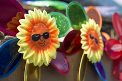 Sunflower pinwheels. Smiling toy sunflower pinwheels under sunshine Stock Photo
