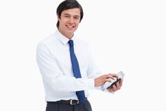Smiling tradesman with his tablet computer. Side view of smiling tradesman with his tablet computer against a white background Stock Photo
