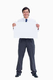 Smiling tradesman holding blank sign Stock Photos