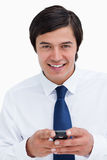 Smiling tradesman holding his cellphone Royalty Free Stock Images