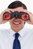Smiling tradesman looking through binoculars Royalty Free Stock Photo