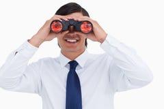 Smiling tradesman looking through spy glass Stock Photos