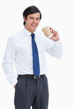 Smiling tradesman with paper cup Royalty Free Stock Photography