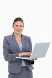 Smiling tradeswoman with her laptop Stock Photos