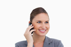 Smiling tradeswoman on her mobile phone Royalty Free Stock Images