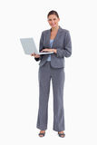 Smiling tradeswoman with her notebook Stock Image