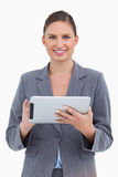 Smiling tradeswoman with her touchscreen computer Royalty Free Stock Images