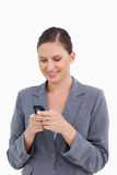 Smiling tradeswoman reading text message Royalty Free Stock Images