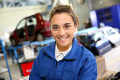 Smiling trainee in repairshop Royalty Free Stock Photography