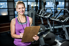 Smiling trainer holding clipboard stock image