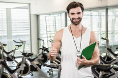 Smiling trainer showing thumb up Stock Photography